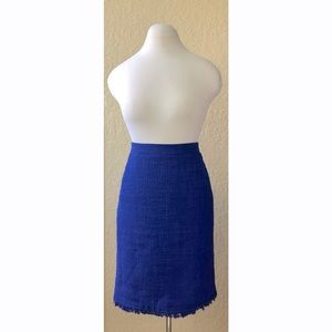 Textured blue pencil skirt raw fringe hemline